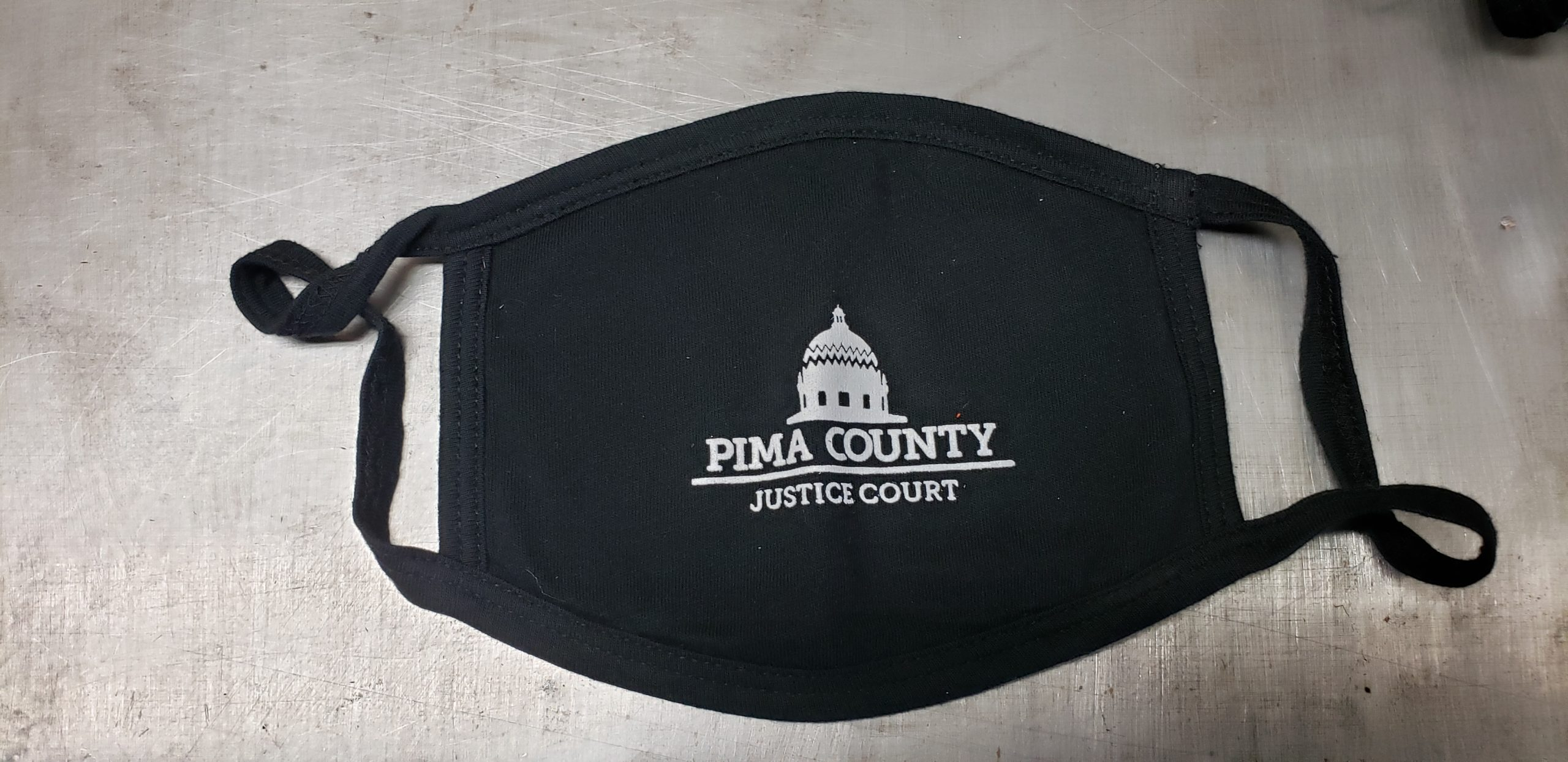 Black cotton face mask with union screen printed one color design for the Pima County Justice Court